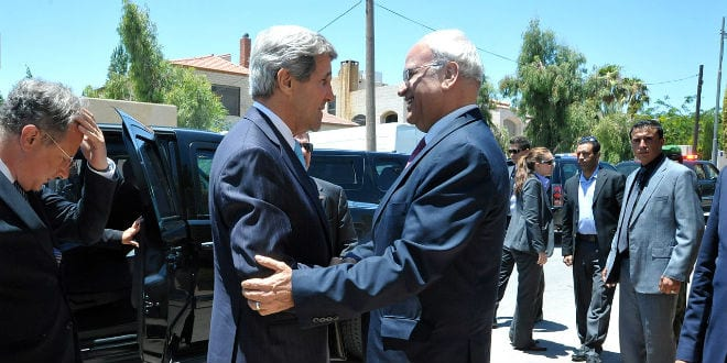 U.S. Secretary of State John Kerry is greeted by Saeb Erekat, chief negotiator for the Palestinian Authority, before a meeting in Amman, Jordan, on June 28, 2013. (Photo: State Department Photo/ Wiki Commons)