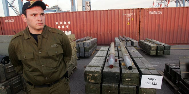 Israeli military police officers stand next to rockets seized by Israeli authorities on a ship near Cyprus, and presented in the port of the Israeli city of Ashdod, Wednesday, Nov. 4, 2009. Israeli commandos seized a ship Wednesday that defense officials said was carrying hundreds of tons of weapons from Iran bound for Lebanon's Hezbollah guerrillas, the largest arms shipment Israel has ever commandeered. (Photo: IDF Spokesperson/FLASH90)