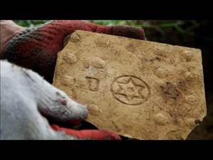 Tile from Treblinka's gas chamber, complete with Star of David. (Photo: Youtube)