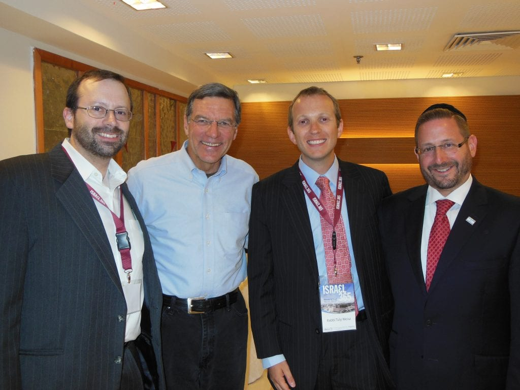 Shavei Israel director Michael Freund, Chris Mitchell of CBN, Rabbi Tuly Weisz of Israel365, and MK Dov Lipman gather together to honor the city of Jerusalem.