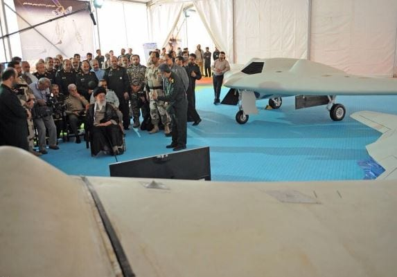 Khameini listening to an IRGC official about the new drone. (Photo: #Khemeini.ir/ Twitter)