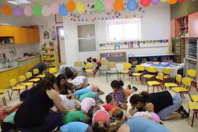 Children in southern Israel brace for impact as a Red Alert siren warns of an incoming rocket from Gaza. (Photo: IDF)