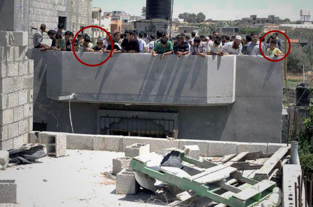 Hamas urges civilians, including children, to stand on the roof of a target where the IDF has warned of an impending strike.