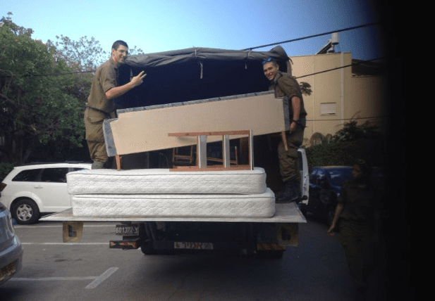 Delivering furniture to poverty stricken IDF soldiers. (Photo: Karmey Chesed)