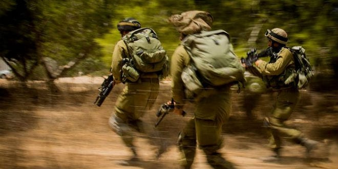 IDF soldiers storming a target in Gaza. (Photo: IDF)
