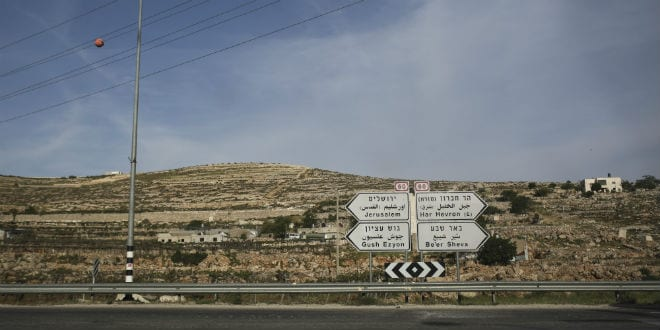 A road signs signifying on Route 60, pointing ways to Jerusalem, Hebron Mountain, Beersheba, and Gush Etzion, in South Hebron Mountain, in Judea and Samaria, on April 23, 2014. (Photo: Hadas Parush/Flash 90)