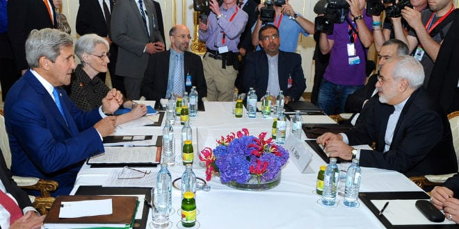 U.S. Secretary of State John Kerry (in center, left side) prepares to sit down with Iranian Foreign Minister Mohammad Javad Zarif (in center, right side) in Vienna, Austria, on July 14, 2014, before they begin a bilateral meeting focused on Iran's nuclear program. (Photo: State Department)