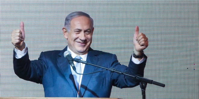 "Israeli Prime Minister and leader of the ""Likud"" party Benjamin Netanyahu waves to supporters at the Likud party headquarters in Tel Aviv on March 18, 2015, after the exit polls in the Israeli general elections were announced, with PM Netanyahu claiming victory. (Photo: Miriam Alster/FLASH90)"