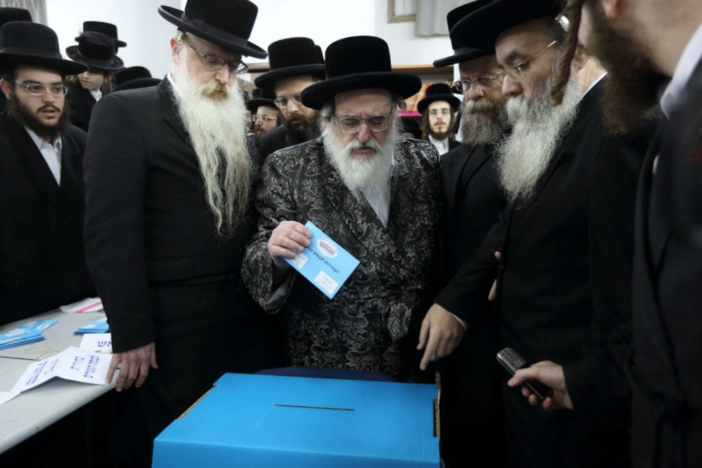 An ultra orthodox jewish man casts his vote at a polling station in the Israeli Bnei Brak on March 17, 2015, in the Israeli general elections for the 20th parliament. Photo by Yaakov Naumi /FLASH90