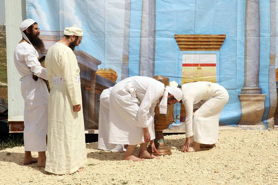 Kohanim washing their hand and feet at the Copper Laver before they begin the day's service in the Holy Temple. (Photo: The Temple Institute)