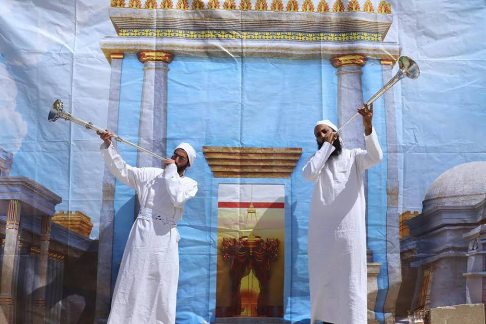 Kohanim blowing silver trumpets, an integral part of the Korban Pesach (Passover offering) at the Holy Temple. (Photo: The Temple Institute)