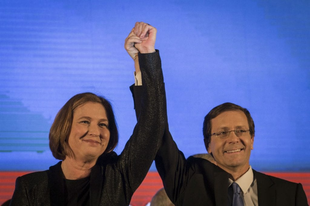 """Co-founders of the """"Zionist Camp"""" political party, Isaac Hertzog and Tzipi Livni, at the party's headquarters in Tel Aviv, after the exit polls in the Israeli general elections for the 20th parliament were announced on March 17, 2015. Photo by Hadas Parush/FLASH90"""