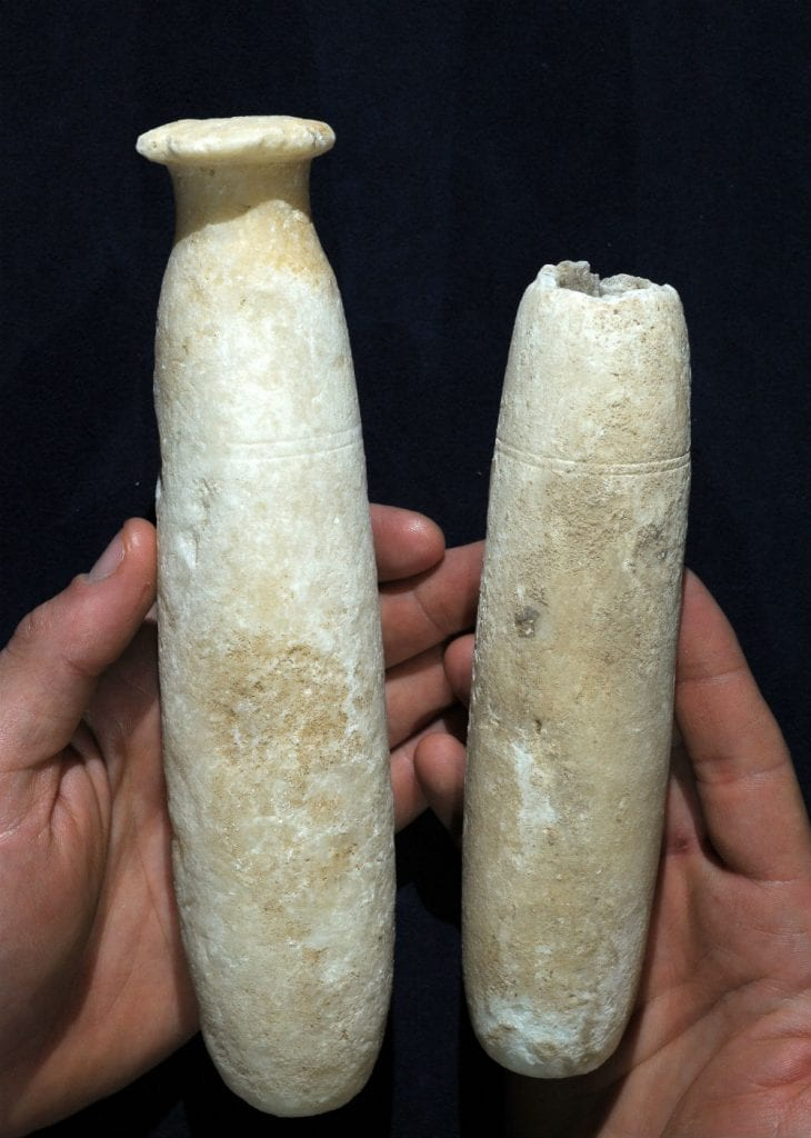 Alabaster bottles that were discovered in the cave. (Photo: Clara Amit/ Israel Antiquities Authority)