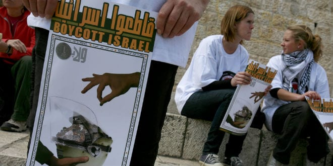 Foreign peace activists holds posters calling to boycott Israel during a protest outside the Damascus Gate in Jerusalem s Old City March 30, 2009. (Photo: Olivier Fitoussi /FLASH90)