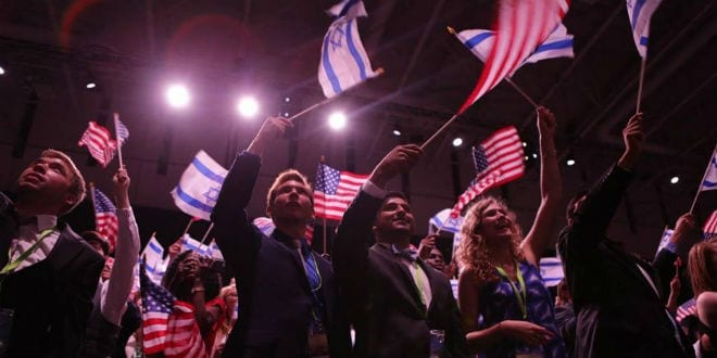 Attendees of the 10th Christians United for Israel (CUFI) Washington Summit wave Israeli and American flags on July 13. (Photo: CUFI/Facebook)