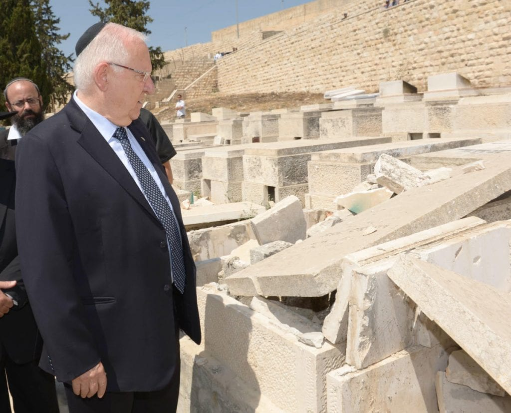 President Reuven Rivlin at the Mount of Olives Cemetery. (Photo: Mark Nyman/GPO)