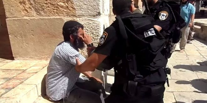 A Jewish man being carried off by Israeli Police from the Temple Mount for reciting the Jewish prayer of Shema. (Photo: Video Screenshot)