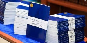 Copies of the newly released Israel Bible at the Siyum event. (Photo: D2 Photography / Breaking Israel News)