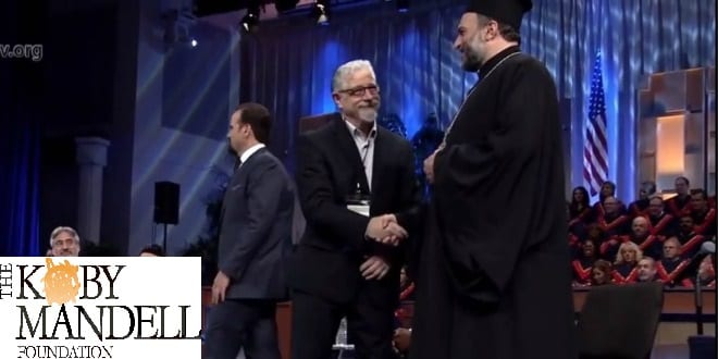 Rabbi Seth Mandell, head of the Kobi Mandell Foundation shakes hands with Father Gabriel Naddaf of the Israeli Christian Recruitment Forum. (Photo: Screenshot)