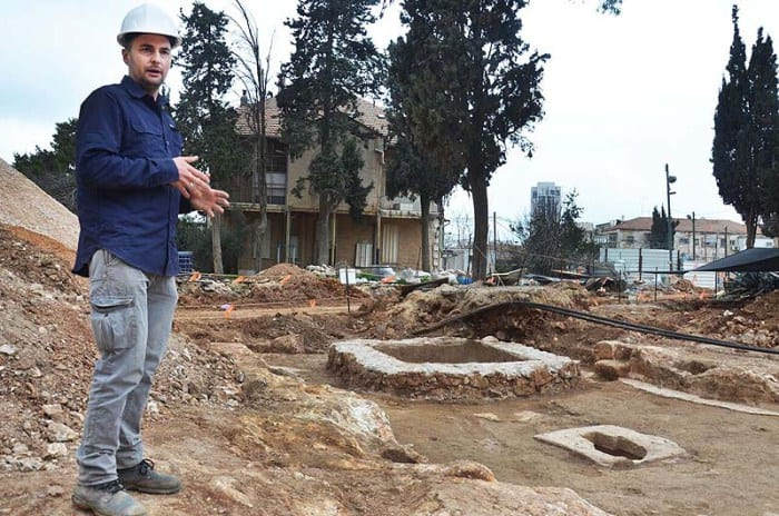 Excavation director, Alex Wiegmann, alongside the complex winery. Different flavor wines were probably produced in it. (Photo: Israel Antiquities Authority./JNi Media)
