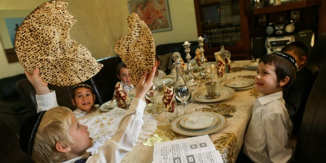 Children sit around the table and simulate The Passover Seder (Photo: Nati Shohat/Flash90)