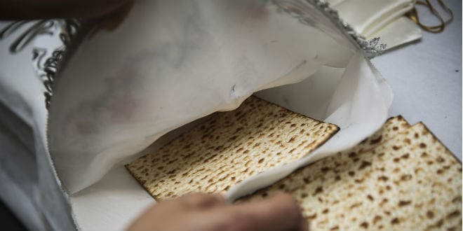 The matzah is placed back in the cloth. (Photo: Shutterstock)