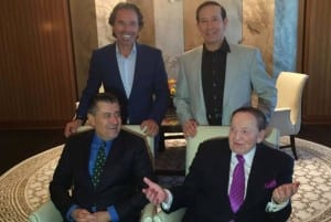 Adam Milstein (standing, right) along with Sheldon Adelson (seated, right) and Chaim Saban (seated, left) in Las Vegas at the Campus Maccabee Summit in June 2015. (Adam Milstein Facebook)