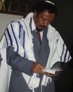 A new Malagasy Jew prays with his talit (prayer shawl) and siddur. (Photo: Barbara Vinick/Kulanu Madagascar)