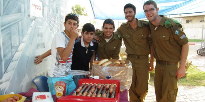 IDF soldiers and Sderot youth celebrate the opening of the new youth center sponsored by Meir Panim and TikvaHope (Photo: Tsivya Fox/Israel Media Network)