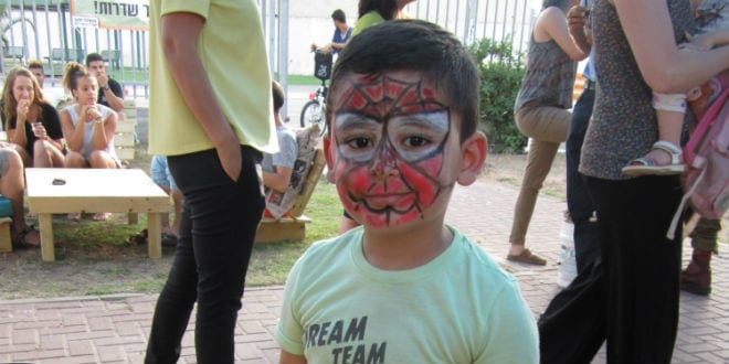 A child from Sderot joins in the celebrations as the new youth center in the city, sponsored by Meir Panim and TikvaHope, is dedicated. (Photo: Tsivya Fox/Israel Media Network)