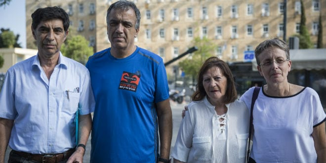 Parents of late Israeli soldiers Oron Shaul and Hadar Goldin speak with the press outside the prime minister's office in Jerusalem after meeting with United Nations Secretary-General Ban Ki-moon and Israeli Prime Minister Benjamin Netanyahu on June 28, 2016. (Photo: Hadas Parush/Flash90)
