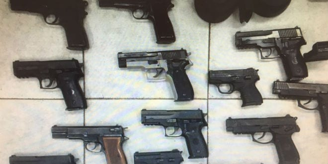 Shin Bet and the Israel Police seized 20 nine- millimeter handguns, five M-16 assault rifles, various parts for automatic weapons, and optical equipment during a smuggling attempt 20.7.16. (Photo: Courtesy of the Israel Police Spokesperson)