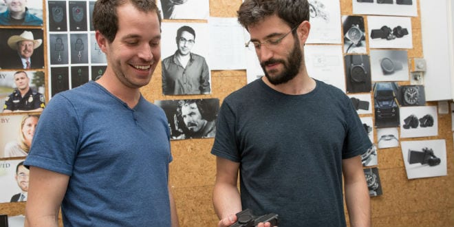 Yonatan Zimmerman (R), Founder and CEO of Zore, and Yalon Fishbein (L), Co-founder and CTO, with the gun lock they developed. (Photo: Hillel Maeir/TPS)