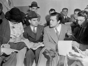 Orson Welles meeting with reporters to explain that the War of the Worlds radio broadcast was not supposed to cause panic. (Acme News Photos/Wikimedia Commons)