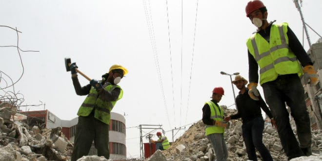 Palestinian workers re-build the commercial center which was destroyed by Israeli shelling during operation protective edge, in Rafah in the southern Gaza Strip, on April 20, 2015. Funded by the United Nations Development Programme (UNDP). (Abed Rahim Khatib /Flash 90)