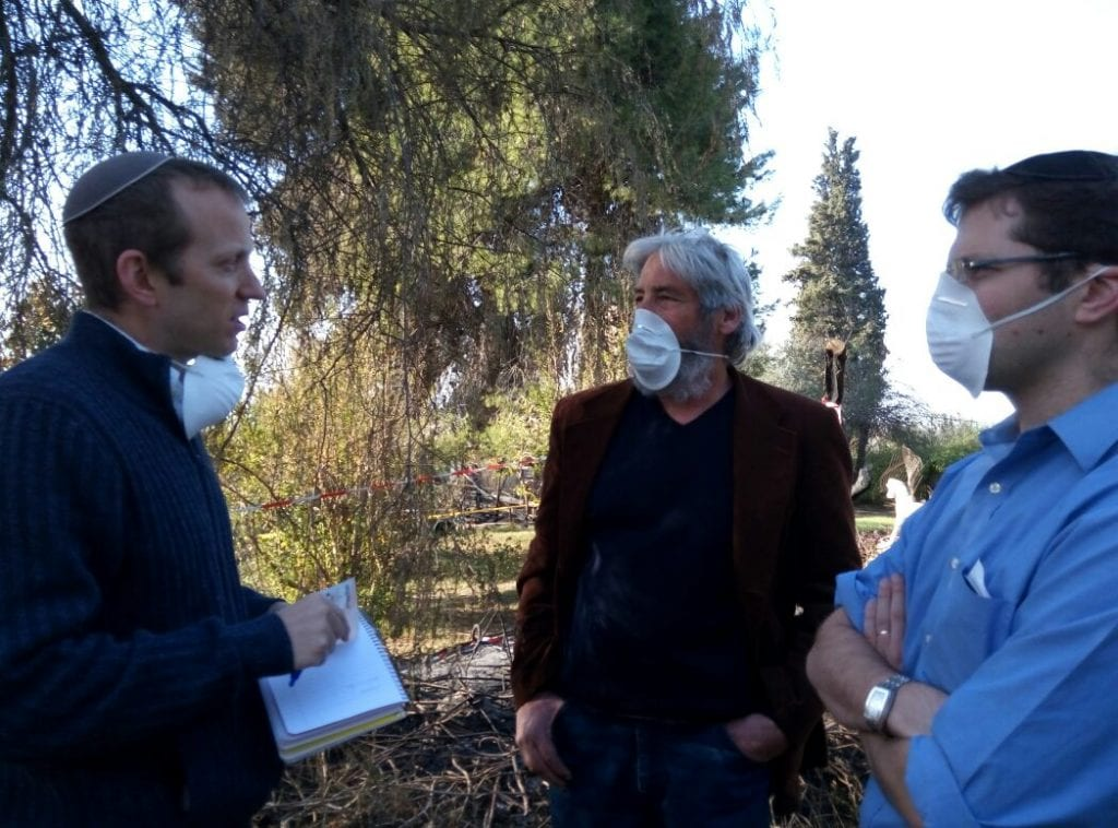 From left, Rabbi Weisz, Yoram Ranaan, and Shlomo Schreibman in Beir Meir (Israel365)