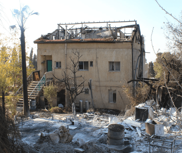 A home damaged by fire, November 2016. (Israel365)