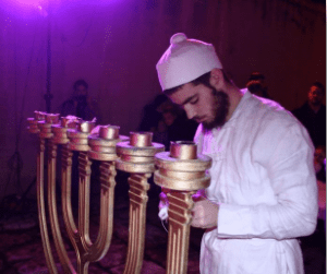 A Jewish priest with a menorah replica. (Courtesy Yaki Savir)