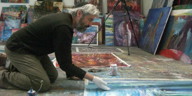 Yoram Raanan in his studio before the fire. (TPS/Courtesy)
